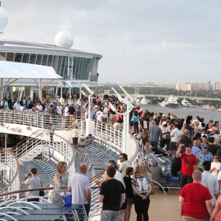 Crowds on the top deck level 17 watching as we sailed out