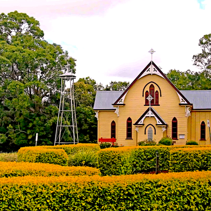 Old Style Church building with nicely manicured plants